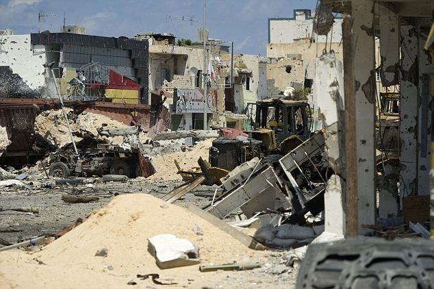 Picture taken on April 18, 2011 shows destroyed buildings in Tripoli street in central of Misrata, 120 kms (75 miles) east of Tripoli, during heavy clashes between Libyan rebels and fighters loyal to Moamer Kadhafi. Snipers, cluster bombs and intense shelling are spreading panic in Misrata, an AFP reporter said today, as a doctor reported 1,000 people killed in six weeks of fighting in the besieged city. AFP PHOTO / ODD ANDERSEN (Photo credit should read ODD ANDERSEN/AFP/Getty Images)